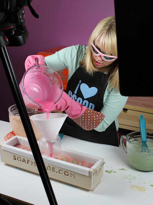 Anne-Marie pouring pink soap for the funnel pour project episode of Soap Queen TV